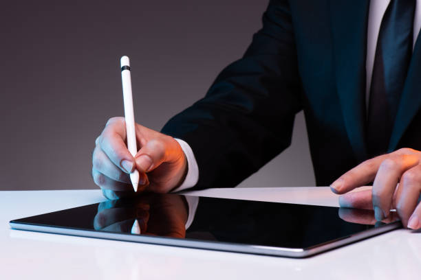 Signing Digital Document On Digital Tablet stock photo