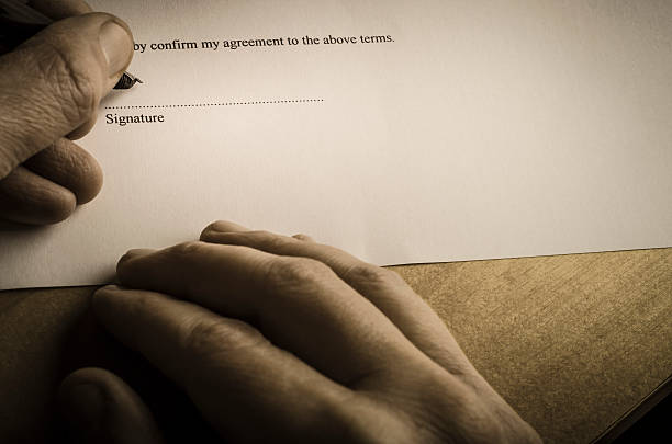 signing document - austere light - dotted line stock photos and pictures