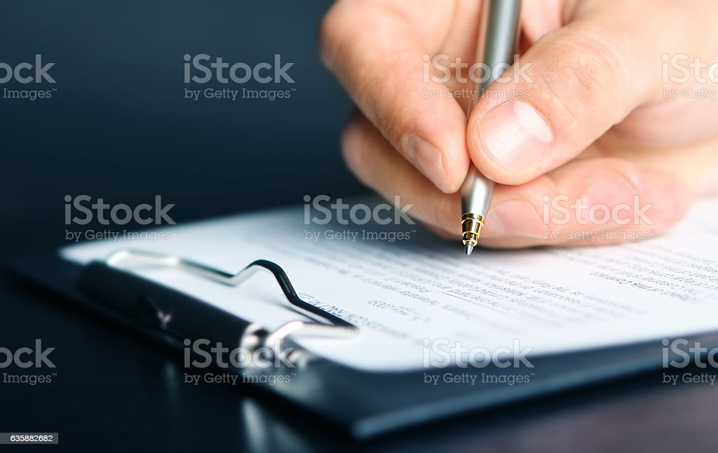 signing finance contract stock photo