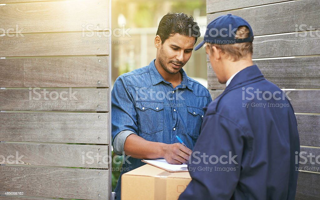 Signing for his package stock photo
