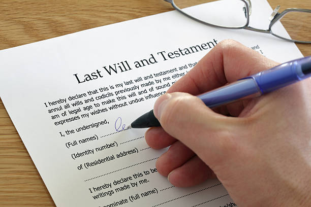 Signing Last Will and Testament Signing Last Will and Testament document last stock pictures, royalty-free photos & images