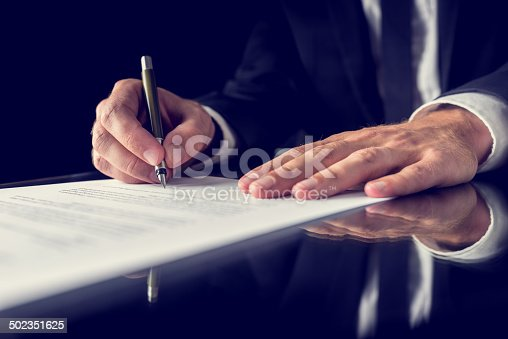 istock Signing legal document 502351625