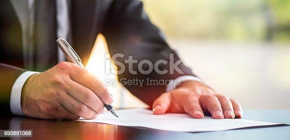 istock Signing Legal Document 693881068