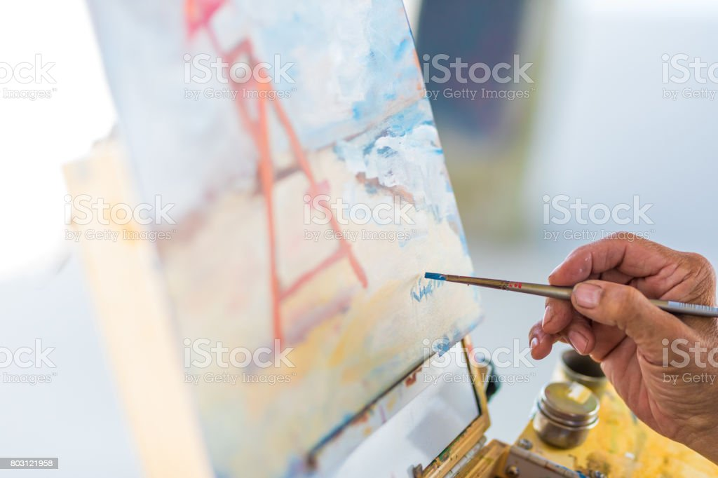 Signing my painting stock photo