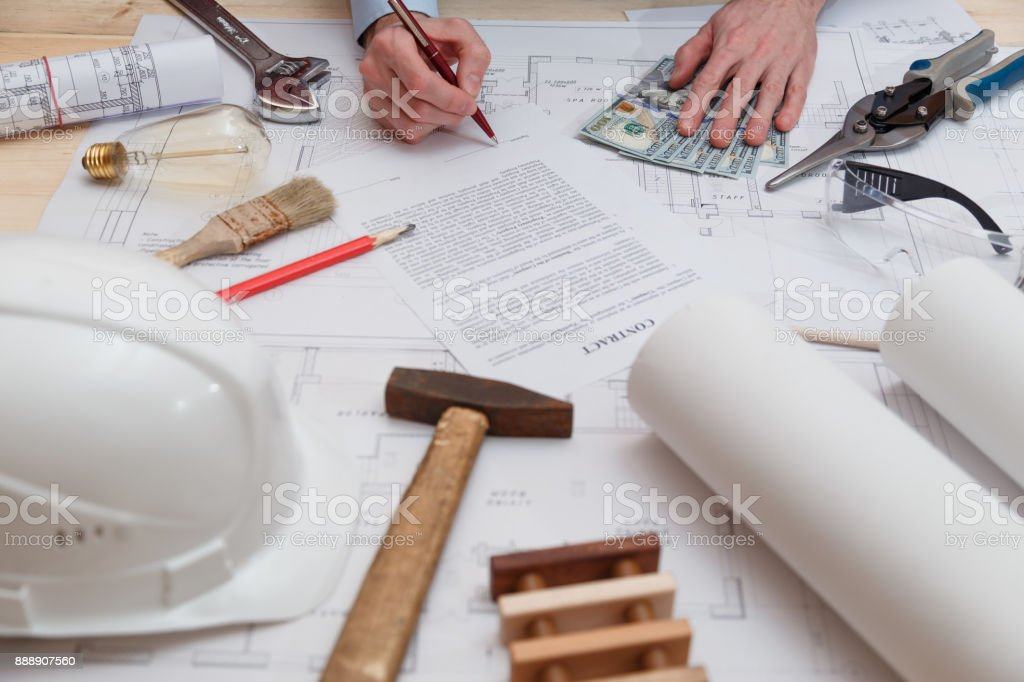 Signing of the contract and payment for construction and engineering works stock photo