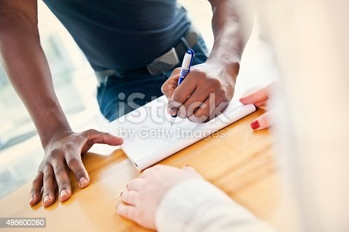 Signing of the contract for raising a loan for a new house.