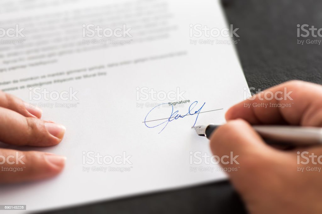 Signing Official Document Or Contract stock photo