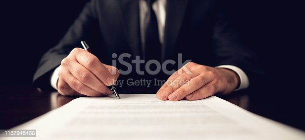 istock Signing Official Document 1137948466