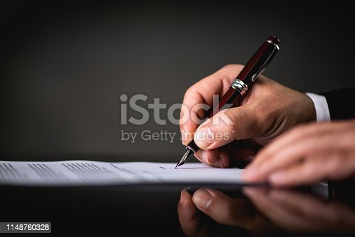 istock Signing Official Document 1148760328