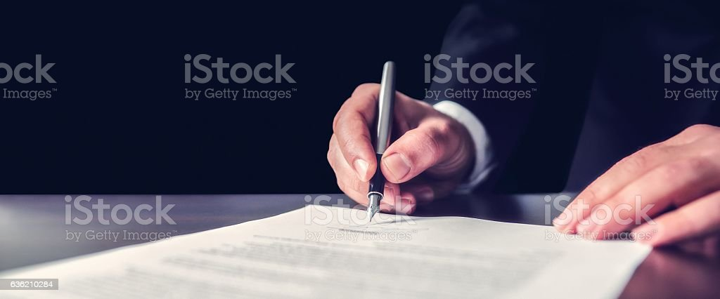Signing Official Document - foto de acervo