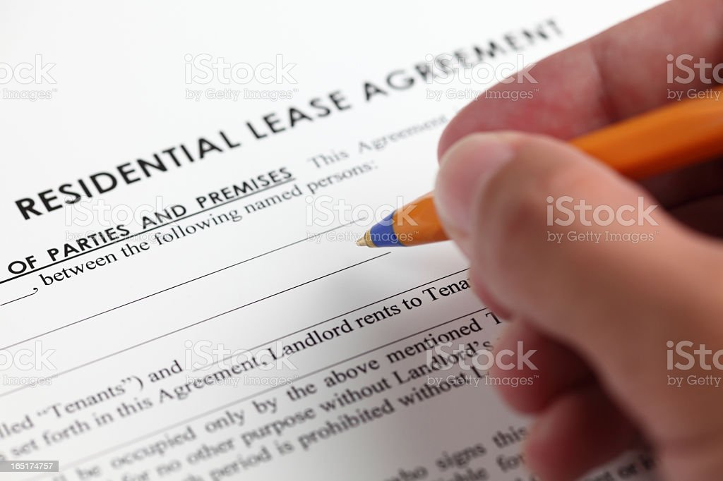 Signing residential lease agreement stock photo