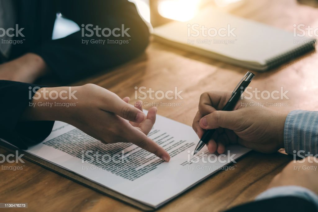 Signing the agreement in the contract. Signing the agreement in the contract. Adult Stock Photo