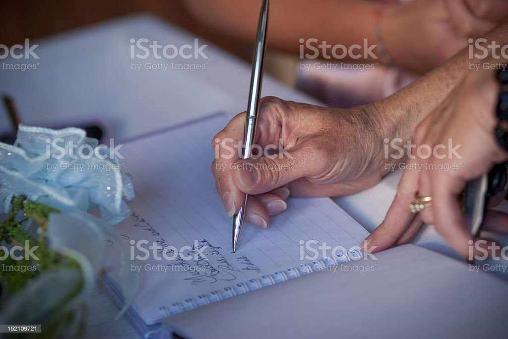 Signing the Guestbook royalty-free stock photo
