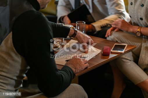 1072035844istockphoto Signing the papers 1194925110