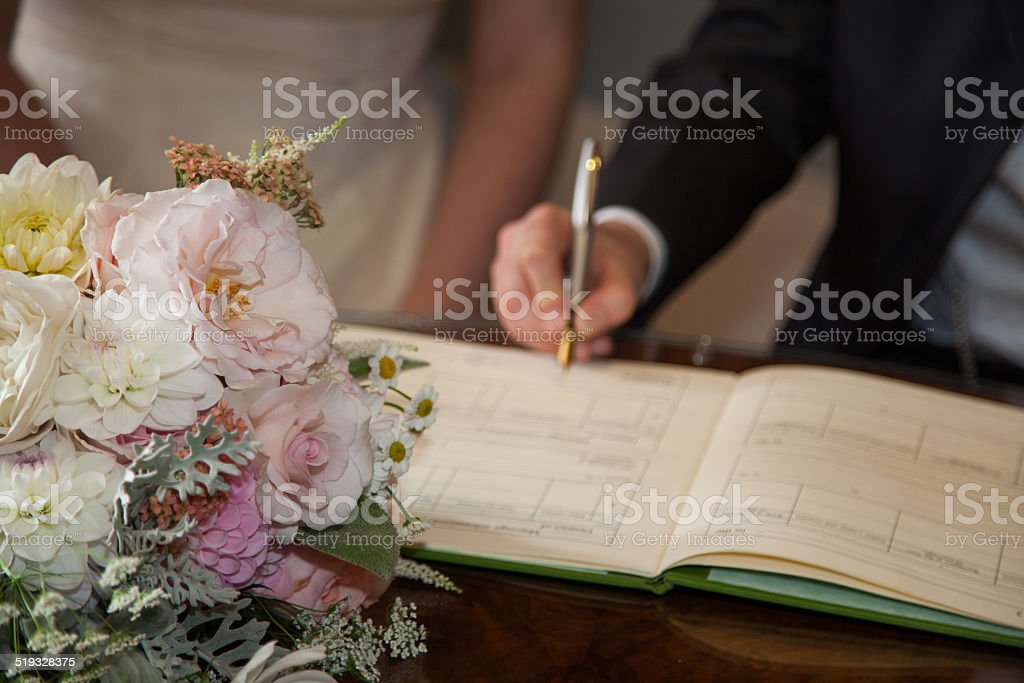 signing the register at a wedding stock photo more pictures of
