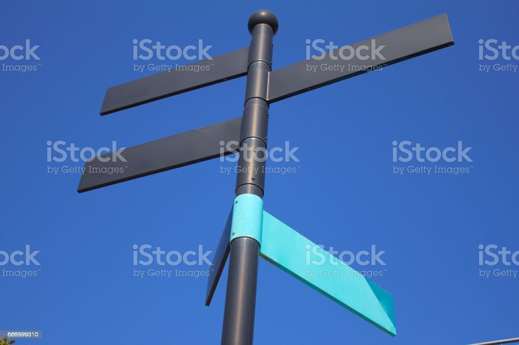 Signpost - black and blue stock photo