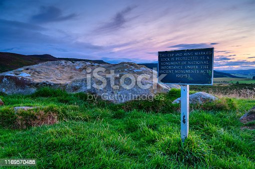 istock Signpost for Protected Monument at Lordenshaws Hillfort 1169570488
