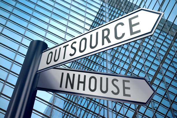 Signpost illustration, two arrows - inhouse, outsource Crossroads sign with two arrows, office building - inhouse, outsource   outsourcing stock pictures, royalty-free photos & images