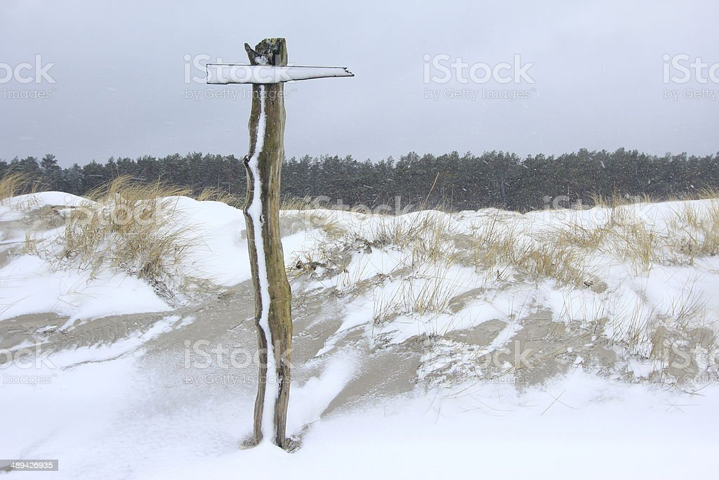 Signpost in the snow storm stock photo