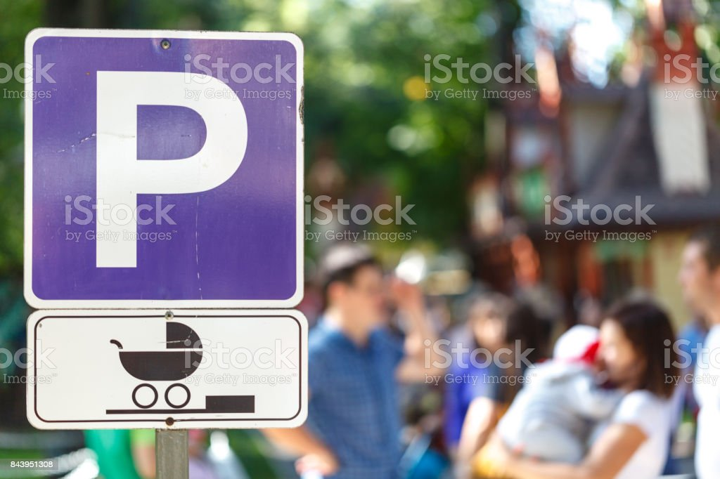 signpost marking a parking area especially for women with babies stock photo