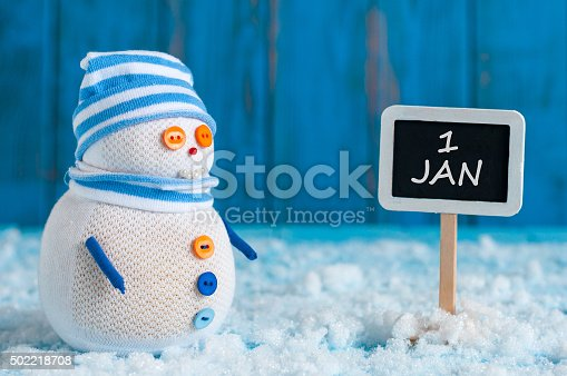 istock Signpost of the 1 January and two Snowman with red 502218708