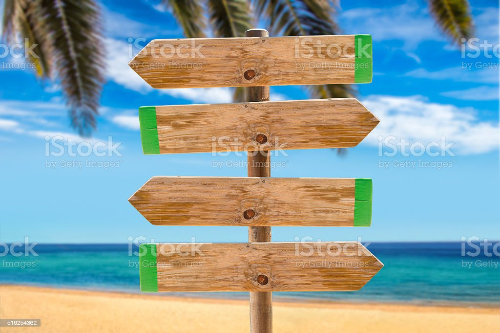 signpost on the beach palm stock photo