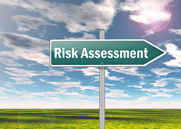Signpost Risk Assessment Signpost with Risk Assessment wording scrutiny stock pictures, royalty-free photos & images