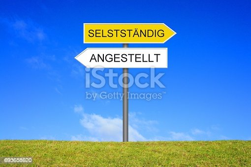 Signpost outside is showing Employed or Self-Employed in german language