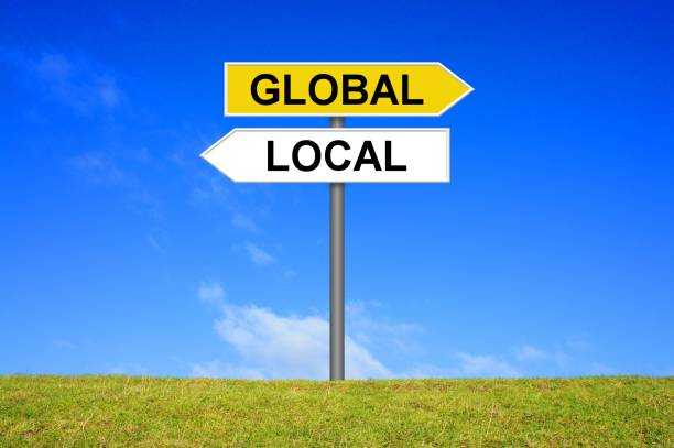 Signpost showing Global and Local stock photo