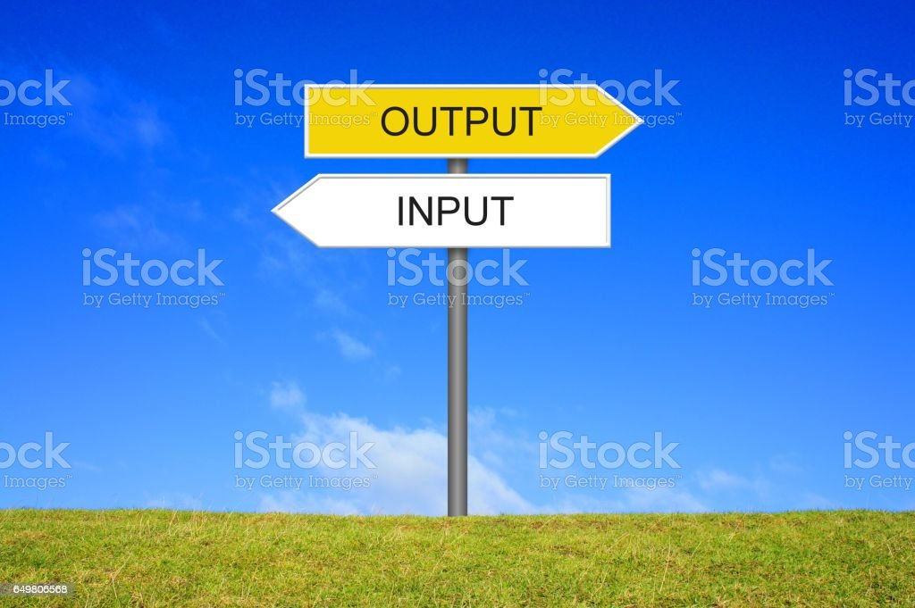 Signpost showing Input Output stock photo