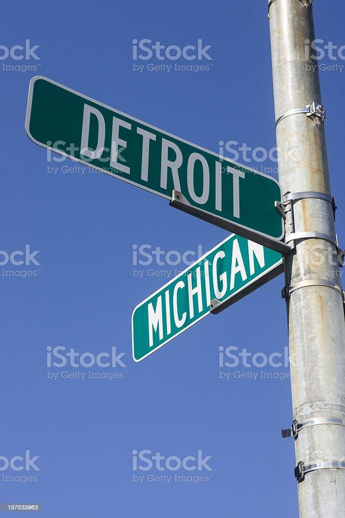 Signpost signaling Detroit and Michigan stock photo