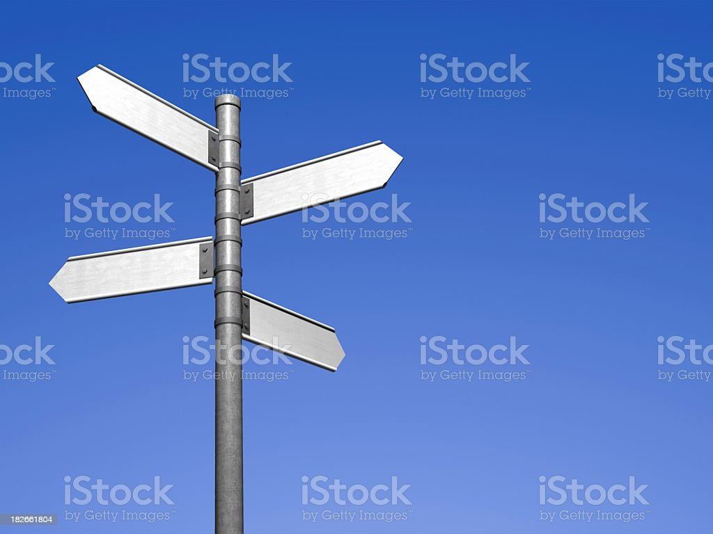 Signpost with four blank street signs stock photo