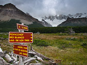 Sign posts for hikers at Cerro Torre trail, El Chalten, Argentina, Patagonia, South America