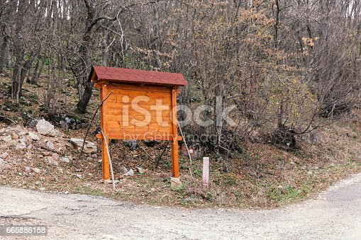 185884645 istock photo Signposts in the woods 665886158