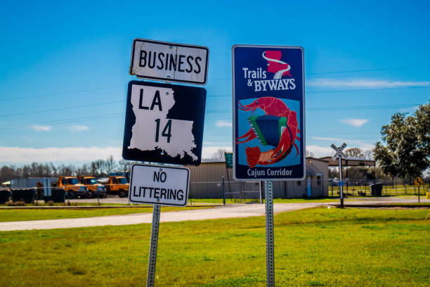 A signs and symbols pole in Abbeville, Louisiana stock photo