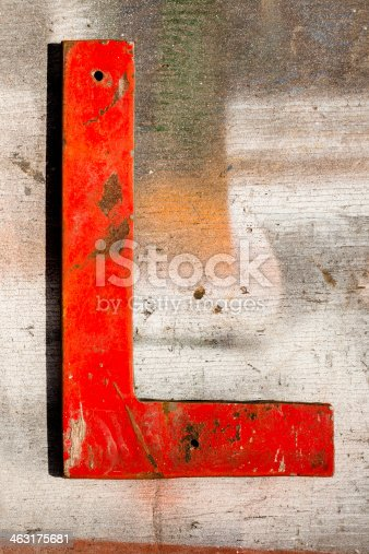 Red capital letter 'L' on an antiqued wooden plank. Click 'Signs' link below for more letters like this one.