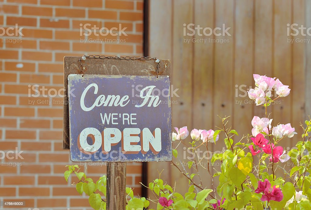 Signs come in we're open. stock photo