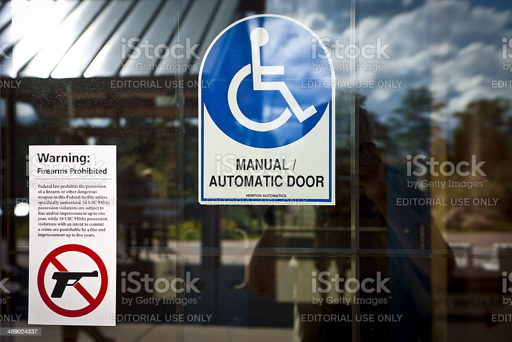 Signs Firearms Prohibited and Invalid Chair USA royalty-free stock photo