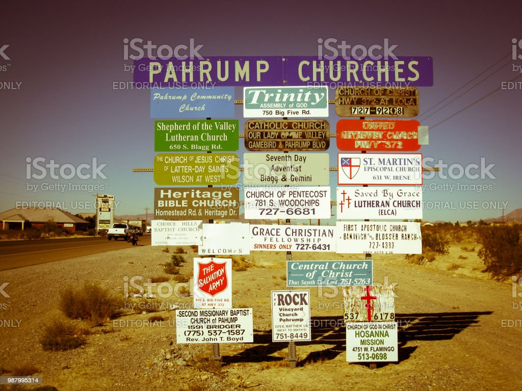 Signs of all religion churches of Pahrump on the side of the road...