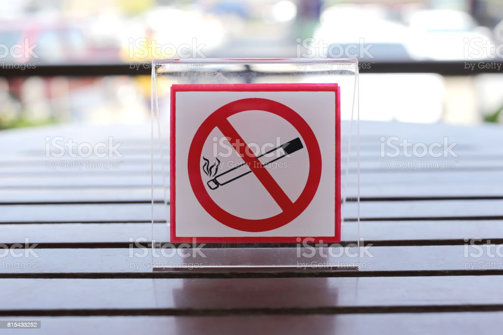 Signs of no smoking on the table in restaurant. stock photo