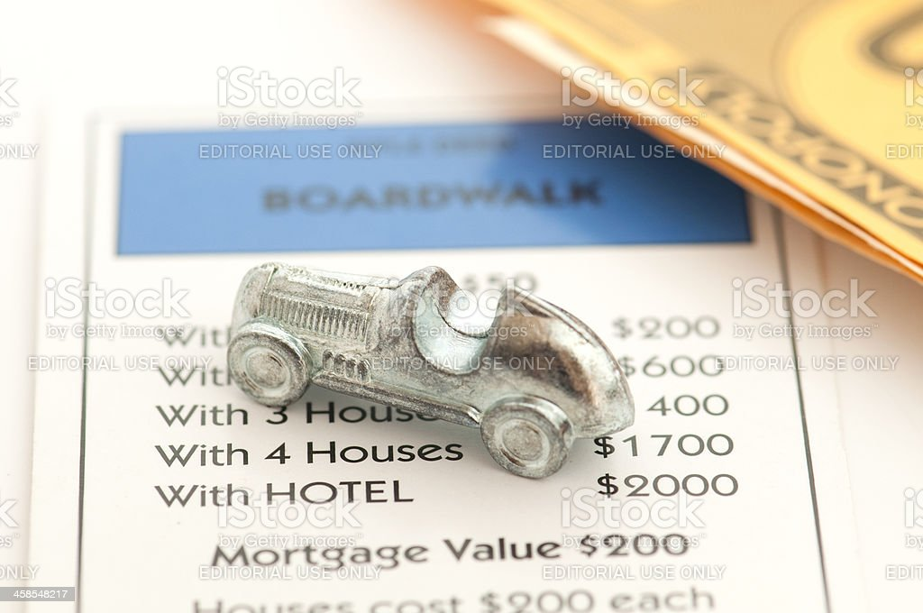 Signs of wealth demonstrated by monopoly pieces stock photo