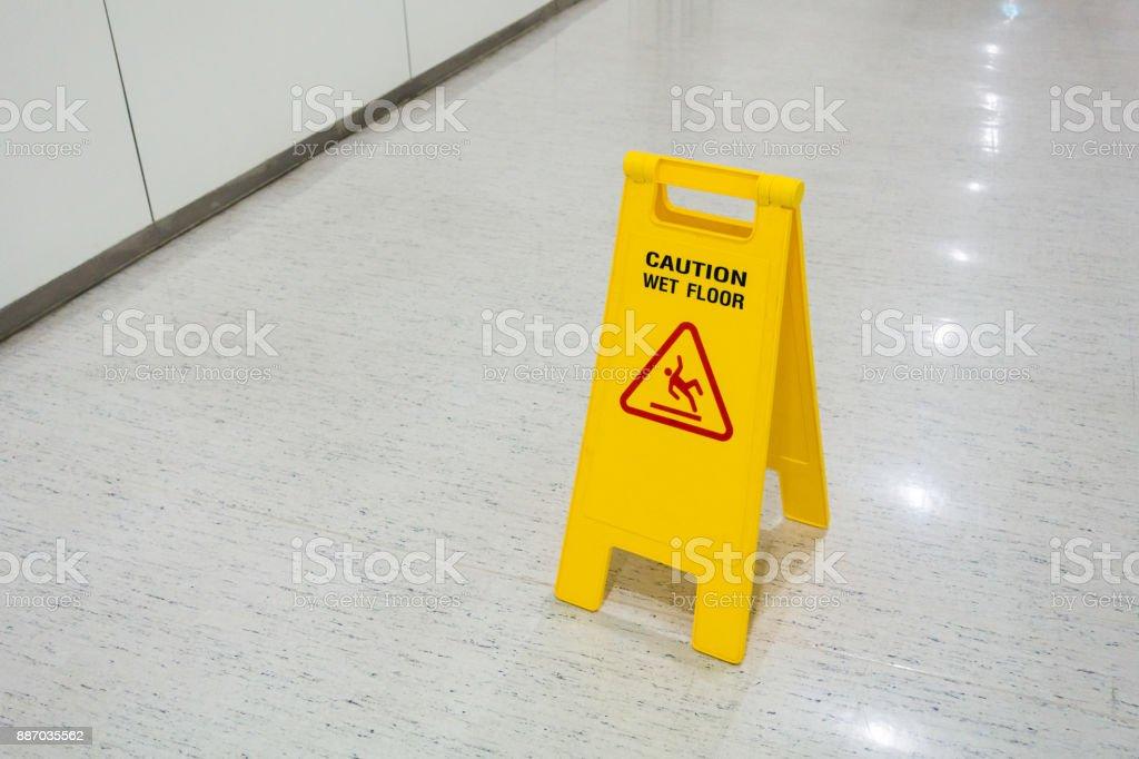Signs plastic yellow put on floor text caution wet floor stock photo