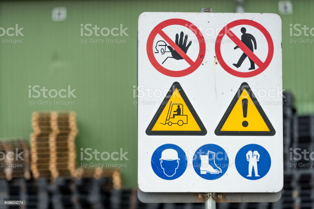 Signs warn of job security. stock photo