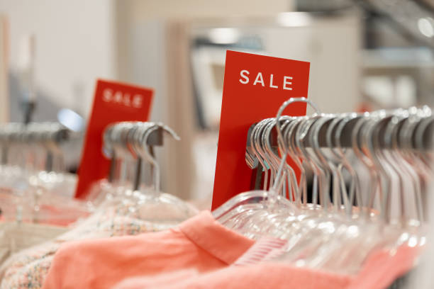 signs with words sale in stores on hangers stock photo