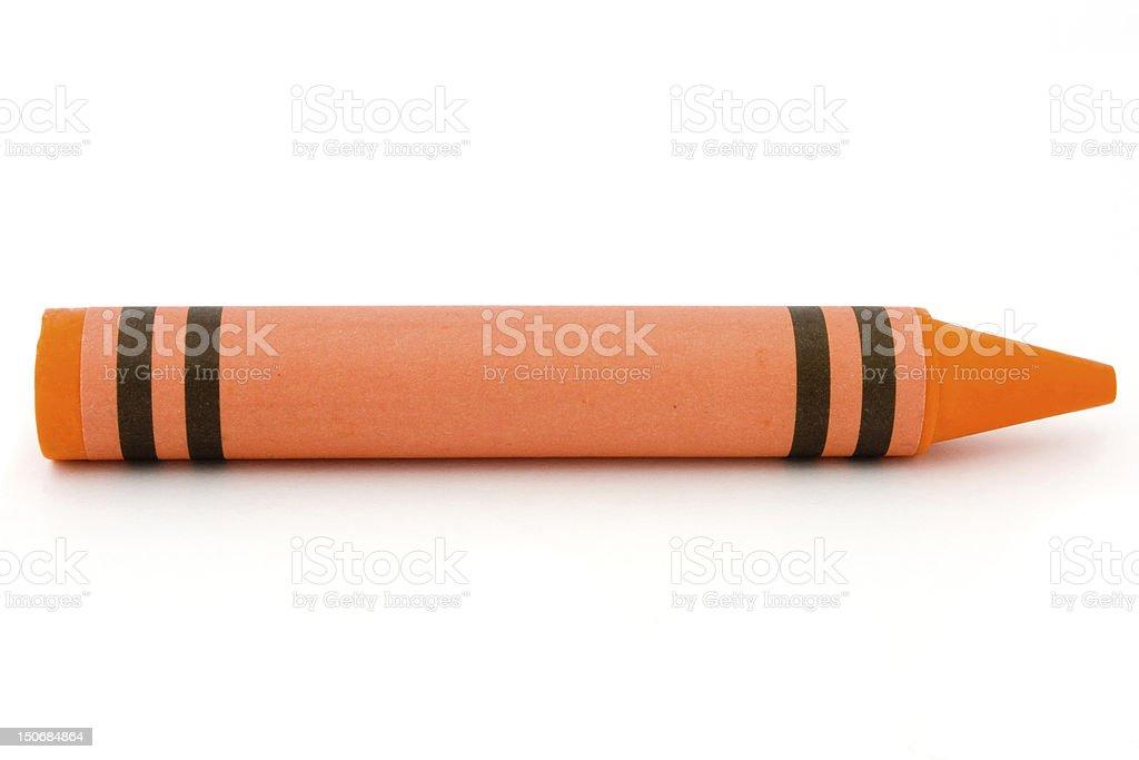 Siingle orange crayon isolated on white stock photo
