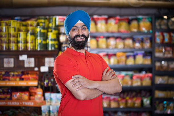 Sikh man at grocery store products stock photo