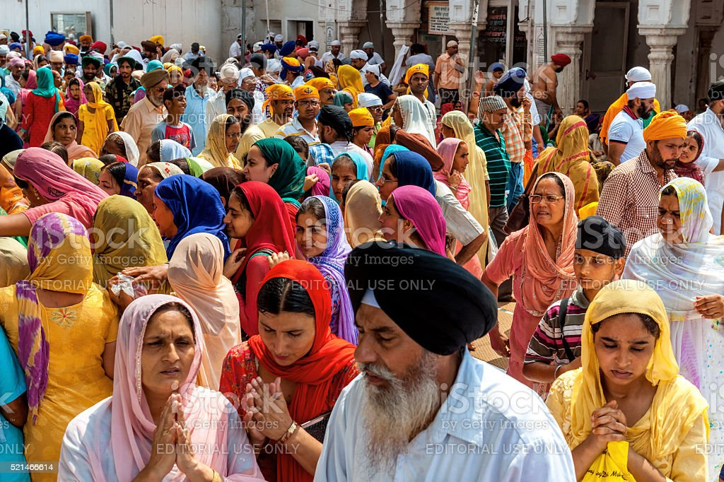 Sikh Pilgrims in Golden Temple Amritsar, India stock photo