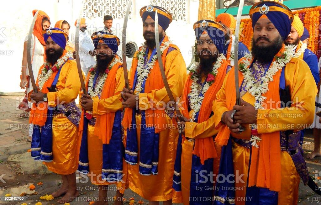 Sikh Punj Pyaares lead float with Guru Granth Sahib or Holy scripture,in Nagar Keertan on birthday of Guru Nanak stock photo