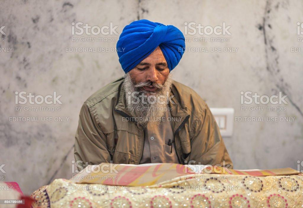 Sikh reding sacred book. stock photo
