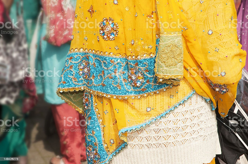 Sikh woman showing colourful sari detail stock photo